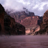A boat in fog on the Colorado River after a rainy night.