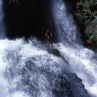 A river guide in Thunder River Falls.