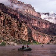 Private boats on the Colorado River in fog.