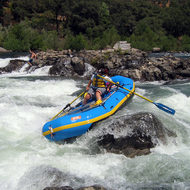 A whitewater rafter running Troublemaker rapid on the South Fork of the American River.