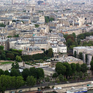 A view from the lower part of the Eiffel tower toward the Arc de Triomphe.