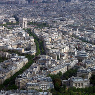 A view from the top of the Eiffel Tower toward the Arc de Triomphe.