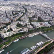 A view from the top of the Eiffel Tower across the Seine to the Arc de Triomphe.