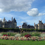 A view of the back side of Fontainebleau Chateau from the gardens.