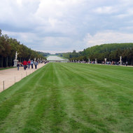 A view of the Versailles gardens, toward the fountain.