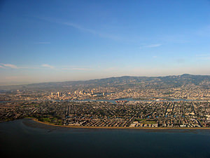 Thumbnail image ofAn aerial view of Alameda (foreground) and Oakland.