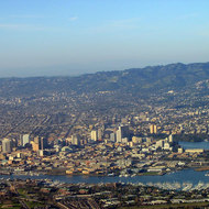 An aerial view of Alameda (foreground), Oakland, and Berkeley (background, note the Campanile tower on the UCB campus).