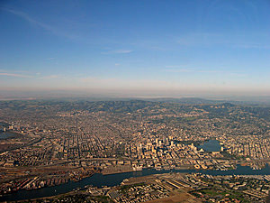 Thumbnail image ofAn aerial view of Alameda (foreground), Oakland...