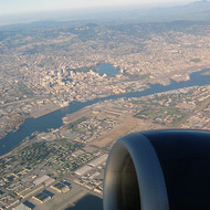 An aerial view of Alameda (foreground), Oakland (including Lake Merritt), and Mount Diablo (background).