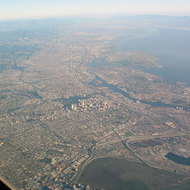 An aerial view of Oakland (foreground), Alameda, and other East Bay cities.