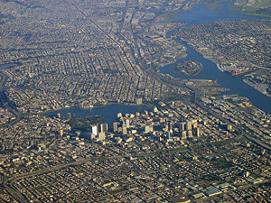 Thumbnail image ofAn aerial view of downtown Oakland (foreground),...