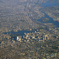 An aerial view of downtown Oakland (foreground), Lake Merritt, and a part of Alameda (right).