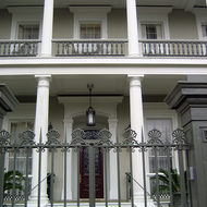 A close-up of a mansion in the Garden District.