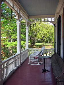 Thumbnail image ofThe front porch of a guest building at the Madewood...