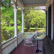 The front porch of a guest building at the Madewood Plantation (near New Orleans).