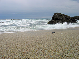 Thumbnail image of A sand-level view of the waves coming in.