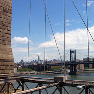 A view of Manhattan (with the Manhattan Bridge and the Empire State Building in the background) from the Brooklyn Bridge.