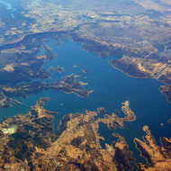 An aerial view of New Melones reservoir, mid-July 2005, with Lake Don Pedro in the background.
