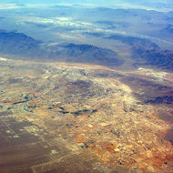 Aerial view of a Nevada city and surrounding desert, mid-July 2005