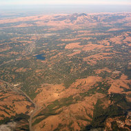 An aerial view of the East Bay (foreground) and Mount Diablo (background).