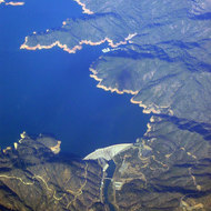 An aerial view of Shasta Lake and Shasta dam.