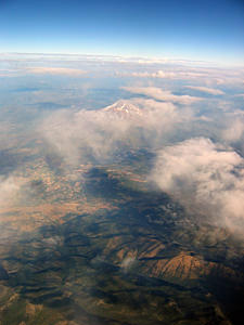 Thumbnail image of An aerial view of Mt. Shasta in late summer.