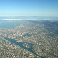 An aerial view of Oakland, Berkeley, Emeryville, Alameda, and surrounding areas.