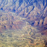 An aerial view of a Southwest river snaking out of the mountains.