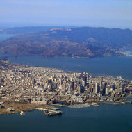 An aerial view of San Francisco, CA, including the Golden Gate Bridge and Marin County.