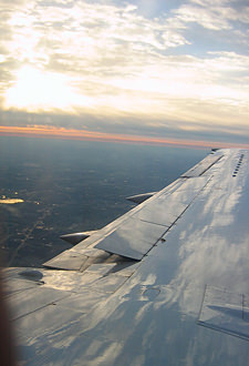 Thumbnail image ofAn over-wing sunset somewhere between Chicago...