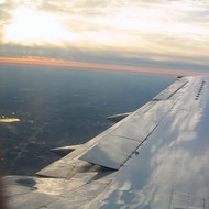An over-wing sunset somewhere between Chicago and Detroit, November 2005.