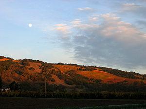 Thumbnail image ofA Fall moonrise and sunset at Kenwood at the northern...
