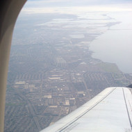 A view of the San Francisco Bay from the window of a plane.