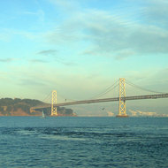 A view of a portion of the Bay Bridge and Yerba Buena Island, looking toward the Alameda shipyards.