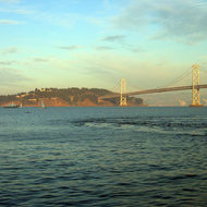 A view of Yerba Buena Island and a portion of the Bay Bridge with Ferry, taken from the Ferry Building in San Francisco.
