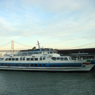 The ferry 'Sonoma' docked at the Ferry Building in San Francisco, with a portion of the Bay Bridge in the background.