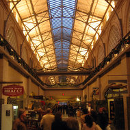 The interior of the Ferry Building in San Francisco, with shops lining a central hall.