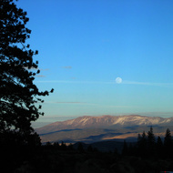 Moonrise over Basin and Range mountains in Nevada while exiting the Sierra Nevada Mountains near Markleeville.