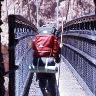 Crossing the Kaibab Trail bridge across the Colorado River at the bottom of the Grand Canyon.