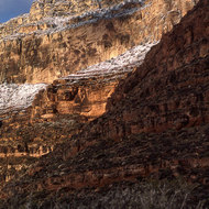 A view of snow-dusted Canyon cliffs in winter.