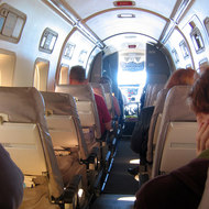 An inside view of a small commercial plane in flight.