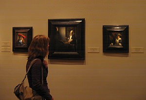 Thumbnail image ofWoman viewing Girl with a Red Hat, Woman Holding...