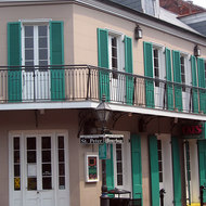 The corner of the famous Bourbon Street and St. Peter street in the French Quarter of New Orleans.