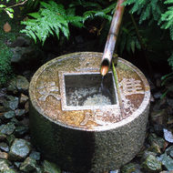 A fountain at Ryoan-ji, the Temple of the Peaceful Dragon, perhaps the most famous of the Japanese dry gardens.