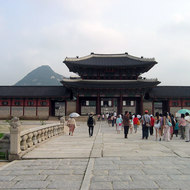 Entering the Gyeongbokgung Palace in Seoul, also known as the Palace of Shining Happiness.