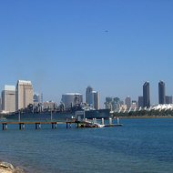 A view of downtown San Diego from Coronado Island, with a Navy ship.