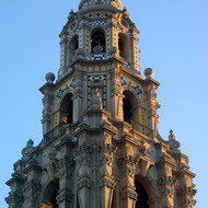 A close-up of the tower of the San Diego Museum of Man at sunset.