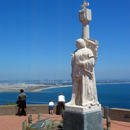 The Cabrillo Monument at Cabrillo National Monument, with Coronado Island and San Diego in the background.