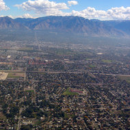 Salt Lake City and the Wasatch Mountains from a landing commercial jet.