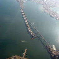The new San Francisco Bay Bridge in construction next to the existing bridge, early October 2006, with part of Treasure Island at the bottom.